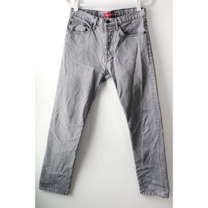 SUPREME • Slim Fit Button Fly Jeans